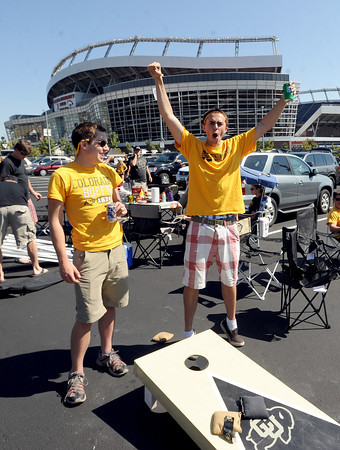 """CU students, Macklin Scheldrop, left, and Brian Mulligan, play bags before the CU CSU game at Sports Authority Field in Denver on Saturday.<br /> For more photos of the game, go to  <a href=""""http://www.dailycamera.com"""">http://www.dailycamera.com</a>.<br /> Cliff Grassmick / September 1, 2012"""