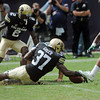 University of Colorado's Woodson Greer (37) scoops up the ball after teammate Kenneth Crawley (2) mishandled the catch on a punt return during a game against Colorado State on Saturday, Sept. 1, 2012 at Sports Authority Field at Mile High.