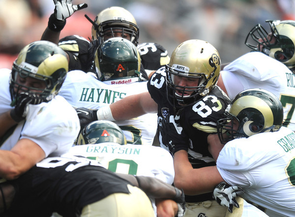 "Will Pericak (83) of CU pressures the CSU QB during the second half of the Rocky Mountain Showdown at Sports Authority Field in Denver on September 1, 2012.<br /> For more photos of the game, go to  <a href=""http://www.dailycamera.com"">http://www.dailycamera.com</a>.<br /> Cliff Grassmick / September 1, 2012"