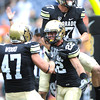 "Nelson Spruce (22) celebrates a TD catch with Tyler McColluch, top, and Alex Wood (47), during the first half of the Rocky Mountain Showdown at Sports Authority Field in Denver on September 1, 2012.<br /> For more photos of the game, go to  <a href=""http://www.dailycamera.com"">http://www.dailycamera.com</a>.<br /> Cliff Grassmick / September 1, 2012"