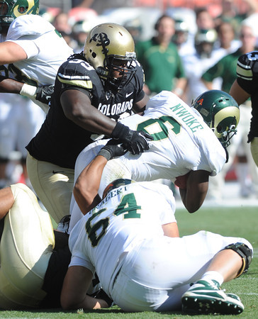 "Nate Bonsu of Colorado stops Chris Nwoke of CSU during the second half of the Rocky Mountain Showdown at Sports Authority Field in Denver on September 1, 2012.<br /> For more photos of the game, go to  <a href=""http://www.dailycamera.com"">http://www.dailycamera.com</a>.<br /> Cliff Grassmick / September 1, 2012"