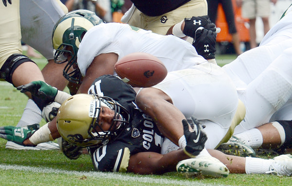 """Malcolm Creer of Colorado, tries to place the ball over the goal line but the ball bounces up for no score during the second half  of the Rocky Mountain Showdown at Sports Authority Field in Denver on September 1, 2012.<br /> For more photos of the game, go to  <a href=""""http://www.dailycamera.com"""">http://www.dailycamera.com</a>.<br /> Cliff Grassmick / September 1, 2012"""