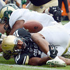 "Malcolm Creer of Colorado, tries to place the ball over the goal line but the ball bounces up for no score during the second half  of the Rocky Mountain Showdown at Sports Authority Field in Denver on September 1, 2012.<br /> For more photos of the game, go to  <a href=""http://www.dailycamera.com"">http://www.dailycamera.com</a>.<br /> Cliff Grassmick / September 1, 2012"