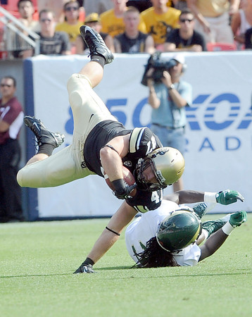 "University of Colorado's Alex Wood goes down hard after being tackled by Shaq Bell during the Rocky Mountain Showdown against Colorado State University on Saturday, Sept. 1, at Sports Authority Field at Mile High in Denver. CSU won the game 22-17. For more photos of the game go to  <a href=""http://www.dailycamera.com"">http://www.dailycamera.com</a><br /> Jeremy Papasso/ Camera"