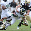 Colorado State's Donnell Alexander, middle, is tackled by Colorado's Ray Polk, left, and Justin Castor on a kickoff return in the second quarter of their game on Saturday, Sept. 1, 2012 at Sports Authority Field at Mile High. (Steve Stoner/Loveland Reporter-Herald)