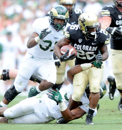 "Tony Jones on the run against CSU during the first half of the Rocky Mountain Showdown at Sports Authority Field in Denver on September 1, 2012.<br /> For more photos of the game, go to  <a href=""http://www.dailycamera.com"">http://www.dailycamera.com</a>.<br /> Cliff Grassmick / September 1, 2012"