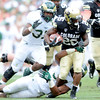 """Tony Jones on the run against CSU during the first half of the Rocky Mountain Showdown at Sports Authority Field in Denver on September 1, 2012.<br /> For more photos of the game, go to  <a href=""""http://www.dailycamera.com"""">http://www.dailycamera.com</a>.<br /> Cliff Grassmick / September 1, 2012"""