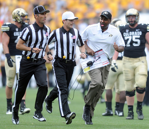 "University of Colorado coach,  Jon Embree, has a conversation with the officials during the second half of the Rocky Mountain Showdown at Sports Authority Field in Denver on September 1, 2012.<br /> For more photos of the game, go to  <a href=""http://www.dailycamera.com"">http://www.dailycamera.com</a>.<br /> Cliff Grassmick / September 1, 2012"