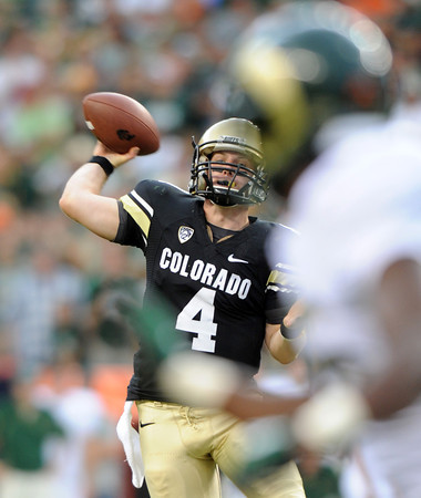 "Jordan Webb of CU throws against the CSU Rams<br /> during the second half of the Rocky Mountain Showdown at Sports Authority Field in Denver on September 1, 2012.<br /> For more photos of the game, go to  <a href=""http://www.dailycamera.com"">http://www.dailycamera.com</a>.<br /> Cliff Grassmick / September 1, 2012"