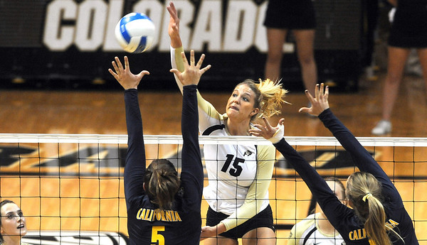 "Nikki Lindow of CU, hits past Adrienne Gehan of Cal.<br /> For more photos of the game, go to  <a href=""http://www.dailycamera.com"">http://www.dailycamera.com</a><br /> Cliff Grassmick / September 22, 2012"