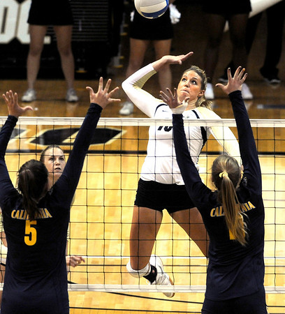 "Nikki Lindow of CU tries to hit past Adrienne Gehan, left, and Kat Brown of Cal on Saturday.<br /> For more photos of the game, go to  <a href=""http://www.dailycamera.com"">http://www.dailycamera.com</a><br /> Cliff Grassmick / September 22, 2012"