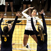 """Nikki Lindow of CU tries to hit past Adrienne Gehan, left, and Kat Brown of Cal on Saturday.<br /> For more photos of the game, go to  <a href=""""http://www.dailycamera.com"""">http://www.dailycamera.com</a><br /> Cliff Grassmick / September 22, 2012"""