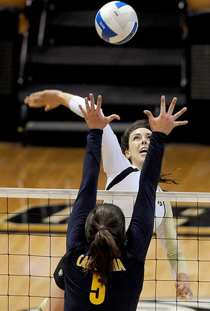 """Kelsey English of CU hits against Adrienne Gehan of Cal.<br /> For more photos of the game, go to  <a href=""""http://www.dailycamera.com"""">http://www.dailycamera.com</a><br /> Cliff Grassmick / September 22, 2012"""