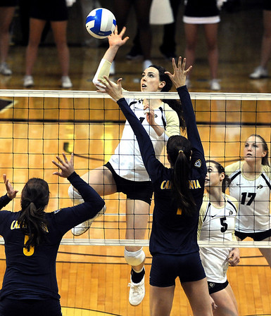 "Kelsey English of CU tries to hit past Adrienne Gehan, left, and Lillian Schonewise of Cal.<br /> For more photos of the game, go to  <a href=""http://www.dailycamera.com"">http://www.dailycamera.com</a><br /> Cliff Grassmick / September 22, 2012"