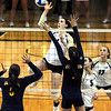 """Kelsey English of CU tries to hit past Adrienne Gehan, left, and Lillian Schonewise of Cal.<br /> For more photos of the game, go to  <a href=""""http://www.dailycamera.com"""">http://www.dailycamera.com</a><br /> Cliff Grassmick / September 22, 2012"""