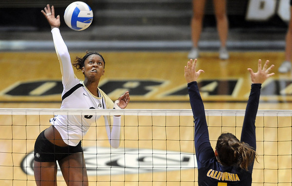 """Alexis Austin of CU, hits past Adrienne Gehan  of Cal.<br /> For more photos of the game, go to  <a href=""""http://www.dailycamera.com"""">http://www.dailycamera.com</a><br /> Cliff Grassmick / September 22, 2012"""