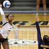 "Alexis Austin of CU, hits past Adrienne Gehan  of Cal.<br /> For more photos of the game, go to  <a href=""http://www.dailycamera.com"">http://www.dailycamera.com</a><br /> Cliff Grassmick / September 22, 2012"