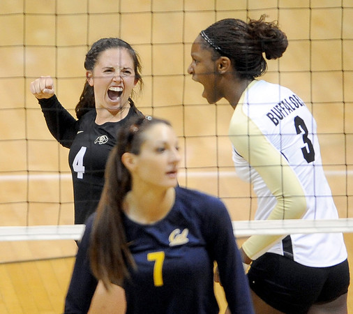 """Elysse Richardson, left, and Alexis Austin, both celebrate a point against Cal.<br /> For more photos of the game, go to  <a href=""""http://www.dailycamera.com"""">http://www.dailycamera.com</a><br /> Cliff Grassmick / September 22, 2012"""