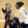 "Elysse Richardson, left, and Alexis Austin, both celebrate a point against Cal.<br /> For more photos of the game, go to  <a href=""http://www.dailycamera.com"">http://www.dailycamera.com</a><br /> Cliff Grassmick / September 22, 2012"