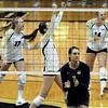 "Michelle Miller, left, Nicoel Edelman and Emily Alexis, all of CU, celebrate a point against Cal. Shannon Hawari is the Cal player #7.<br /> For more photos of the game, go to  <a href=""http://www.dailycamera.com"">http://www.dailycamera.com</a><br /> Cliff Grassmick / September 22, 2012"