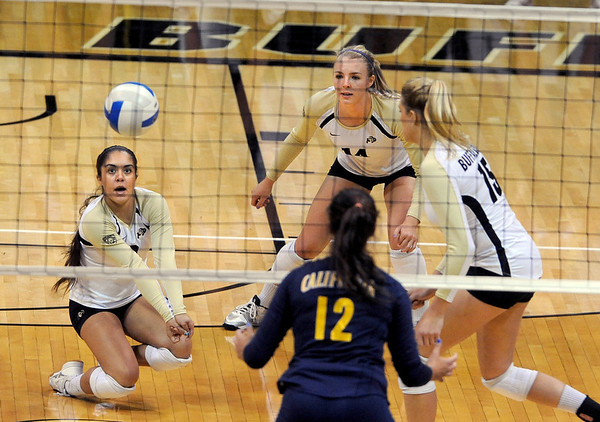 """Chelsey Keoho, left, of CU, digs one out against Cal.<br /> For more photos of the game, go to  <a href=""""http://www.dailycamera.com"""">http://www.dailycamera.com</a><br /> Cliff Grassmick / September 22, 2012"""