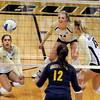"Chelsey Keoho, left, of CU, digs one out against Cal.<br /> For more photos of the game, go to  <a href=""http://www.dailycamera.com"">http://www.dailycamera.com</a><br /> Cliff Grassmick / September 22, 2012"