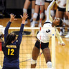 """Alexis Austin of CU, hits past Joan Caloiaro of Cal.<br /> For more photos of the game, go to  <a href=""""http://www.dailycamera.com"""">http://www.dailycamera.com</a><br /> Cliff Grassmick / September 22, 2012"""