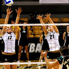 "CU Buffs Alex Penwell, left, and Becah Fogle jump to block the ball spiked by Cal Poly Mustang Anicia Santos at the CU vs. Cal Poly volleyball game at CU-Boulder on Saturday, Sept. 12, 2009.  More photos at  <a href=""http://www.dailycamera.com"">http://www.dailycamera.com</a>."