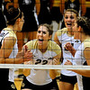 """Kaitlyn Burkett (22) and her teammates celebrate after scoring a point at the CU vs. Cal Poly volleyball game at CU-Boulder on Saturday, Sept. 12, 2009.  More photos at  <a href=""""http://www.dailycamera.com"""">http://www.dailycamera.com</a>."""