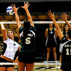 "CU Buff Nikki Kinzer spikes the ball while Cal Poly Mustangs Megan McConnell (5) and Megan McConnell (15) at the CU vs. Cal Poly volleyball game at CU-Boulder on Saturday, Sept. 12, 2009.  More photos at  <a href=""http://www.dailycamera.com"">http://www.dailycamera.com</a>."