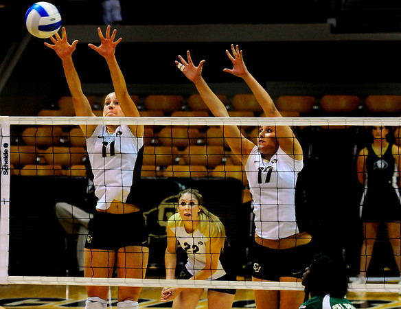 """CU Buffs Rosie Steinhaus, left, and Alex Penewell jump to block the ball at the CU vs. Cal Poly volleyball game at CU-Boulder on Saturday, Sept. 12, 2009.  More photos at  <a href=""""http://www.dailycamera.com"""">http://www.dailycamera.com</a>."""