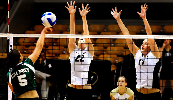 "CU Buffs Rosie Steinhaus, right, and Kaitlyn Burkett, left, jump to block the ball spiked by Cal Poly Mustang Megan McConnell at the CU vs. Cal Poly volleyball game at CU-Boulder on Saturday, Sept. 12, 2009.  More photos at  <a href=""http://www.dailycamera.com"">http://www.dailycamera.com</a>."