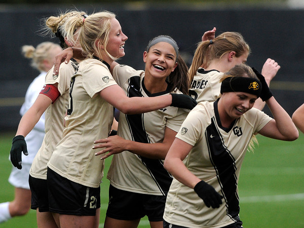 """University of Colorado's Anne Stuller, left, is hugged by teammate Olivia Pappalardo after scoring a goal during a soccer game against the California Golden Bears on Friday, Oct. 5, at Prentup Field in Boulder. For more photos of the game go to  <a href=""""http://www.dailycamera.com"""">http://www.dailycamera.com</a><br />  Jeremy Papasso/ Camera"""