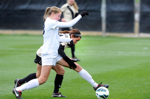 """University of Colorado's Emily Paxton tries to steal the ball from Celeste Boureille during a soccer game against the California Golden Bears on Friday, Oct. 5, at Prentup Field in Boulder. For more photos of the game go to  <a href=""""http://www.dailycamera.com"""">http://www.dailycamera.com</a><br />  Jeremy Papasso/ Camera"""