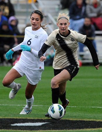 "University of Colorado's Shaye Marshall moves the ball past Hayley Hughes during a soccer game against the California Golden Bears on Friday, Oct. 5, at Prentup Field in Boulder. For more photos of the game go to  <a href=""http://www.dailycamera.com"">http://www.dailycamera.com</a><br />  Jeremy Papasso/ Camera"