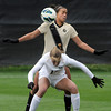 "University of Colorado's Bianca Jones gets hit in the face with the ball while trying to defend Jenna Glad during a soccer game against the California Golden Bears on Friday, Oct. 5, at Prentup Field in Boulder. For more photos of the game go to  <a href=""http://www.dailycamera.com"">http://www.dailycamera.com</a><br />  Jeremy Papasso/ Camera"