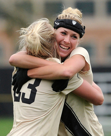 """University of Colorado's Anne Stuller, left, is hugged by teammate Amy Barczuk after scoring a goal during a soccer game against the California Golden Bears on Friday, Oct. 5, at Prentup Field in Boulder. For more photos of the game go to  <a href=""""http://www.dailycamera.com"""">http://www.dailycamera.com</a><br />  Jeremy Papasso/ Camera"""