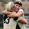 "University of Colorado's Anne Stuller, left, is hugged by teammate Amy Barczuk after scoring a goal during a soccer game against the California Golden Bears on Friday, Oct. 5, at Prentup Field in Boulder. For more photos of the game go to  <a href=""http://www.dailycamera.com"">http://www.dailycamera.com</a><br />  Jeremy Papasso/ Camera"