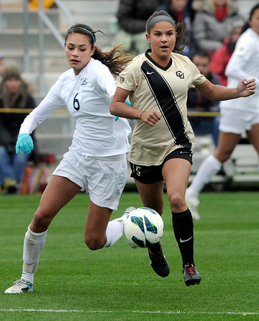 """University of Colorado's Olivia Pappalardo, right, moves the ball past Kaitlyn Fitzpatrick during a soccer game against the California Golden Bears on Friday, Oct. 5, at Prentup Field in Boulder. For more photos of the game go to  <a href=""""http://www.dailycamera.com"""">http://www.dailycamera.com</a><br />  Jeremy Papasso/ Camera"""