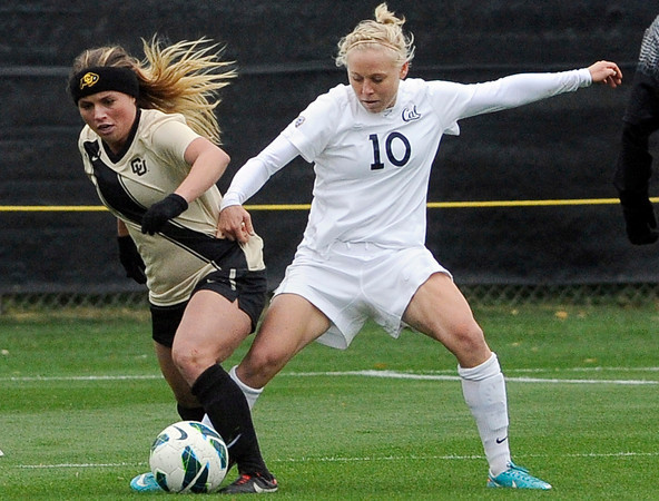 """University of Colorado's Madison Krauser steals the ball from Betsy Hassett, No. 10, during a soccer game against the California Golden Bears on Friday, Oct. 5, at Prentup Field in Boulder. For more photos of the game go to  <a href=""""http://www.dailycamera.com"""">http://www.dailycamera.com</a><br />  Jeremy Papasso/ Camera"""