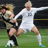 "University of Colorado's Madison Krauser steals the ball from Betsy Hassett, No. 10, during a soccer game against the California Golden Bears on Friday, Oct. 5, at Prentup Field in Boulder. For more photos of the game go to  <a href=""http://www.dailycamera.com"">http://www.dailycamera.com</a><br />  Jeremy Papasso/ Camera"