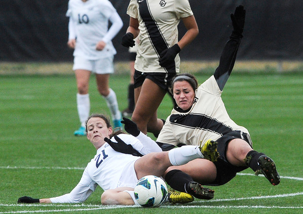"""University of Colorado's Emily Paxton slides after the ball alongside Taylor Comeau, No. 21, during a soccer game against the California Golden Bears on Friday, Oct. 5, at Prentup Field in Boulder. For more photos of the game go to  <a href=""""http://www.dailycamera.com"""">http://www.dailycamera.com</a><br />  Jeremy Papasso/ Camera"""