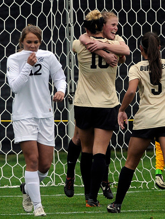 """University of Colorado's Amy Barczuk, No 10, gets a hug from teammate Hayley Hughes after scoring a goal in front of Samantha Walker, No. 12, during a soccer game against the California Golden Bears on Friday, Oct. 5, at Prentup Field in Boulder. For more photos of the game go to  <a href=""""http://www.dailycamera.com"""">http://www.dailycamera.com</a><br />  Jeremy Papasso/ Camera"""