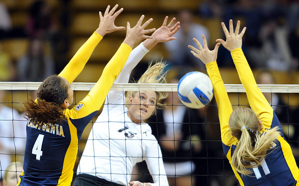 """Nikki Lindow of CU hits between Tarrah Murrey, left, and Kat Brown, both of Cal.<br /> For more photos of CU and Cal, go to  <a href=""""http://www.dailycamera.com"""">http://www.dailycamera.com</a>.<br /> November 5, 2011 / Cliff Grassmick"""
