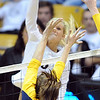 "Kerra Schroeder of CU tries to hit past Shannon Hawari of Cal.<br /> For more photos of CU and Cal, go to  <a href=""http://www.dailycamera.com"">http://www.dailycamera.com</a>.<br /> November 5, 2011 / Cliff Grassmick"