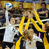 "Lydia Blaha of CU, tries to hit over Kat Brown (11) and Correy Johnson of Cal.<br /> For more photos of CU and Cal, go to  <a href=""http://www.dailycamera.com"">http://www.dailycamera.com</a>.<br /> November 5, 2011 / Cliff Grassmick"