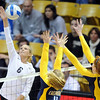 "Kerra Schroeder of CU, tries to hit over Kat Brown (11) and Correy Johnson of Cal.<br /> For more photos of CU and Cal, go to  <a href=""http://www.dailycamera.com"">http://www.dailycamera.com</a>.<br /> November 5, 2011 / Cliff Grassmick"
