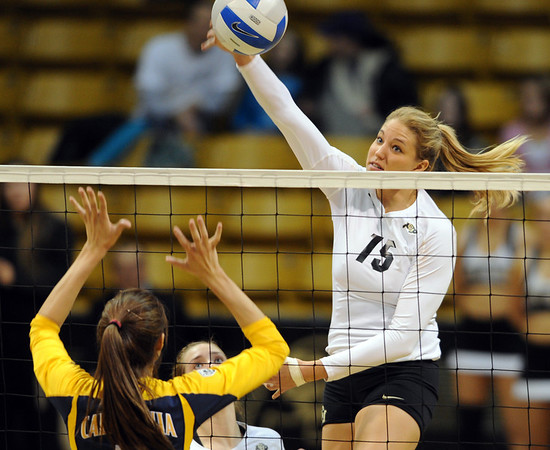 "Nikki Lindow  of CU, hits over Shannon Hawari of Cal.<br /> For more photos of CU and Cal, go to  <a href=""http://www.dailycamera.com"">http://www.dailycamera.com</a>.<br /> November 5, 2011 / Cliff Grassmick"