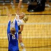 University of Colorado sophomore Kerra Schroeder goes for a kill while Duke sophomore Christiana Gray tries for the block on Saturday, Aug. 28, at the CU vs. Duke volleyball match at the Coors Event Center on the CU campus in Boulder.<br /> Jeremy Papasso/ Camera