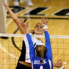 University of Colorado junior Anicia Santos, left, goes a spike over the top of Duke sophomore Christina Curry on Saturday, Aug. 28, at the CU vs. Duke volleyball match at the Coors Event Center on the CU campus in Boulder.<br /> Jeremy Papasso/ Camera